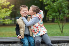 Giving her little brother a kiss outside Royalty Free Stock Images