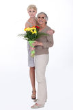 Giving her mother flowers Royalty Free Stock Image