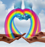 Giving. Hope concept as cupped hands in the sky pouring rainbow colors to community members as a human relief symbol of helping and supporting development to royalty free illustration