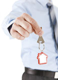 Giving House Key. Businessman giving the keys of the house Royalty Free Stock Images