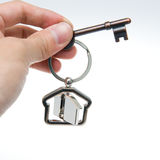 Giving house key Stock Photo