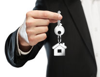 Giving house keys. Businessman gives keys to house Royalty Free Stock Photo