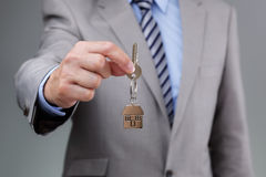 Giving house keys Royalty Free Stock Images
