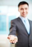 Giving key. Hand of businessman holding key Stock Images