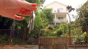 Giving key of a house stock footage