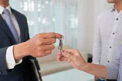 Giving keys to apartment owner royalty free stock image