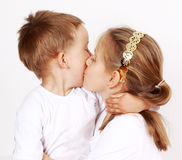 Giving a kiss. Kids giving a kiss to each other Stock Photo