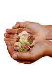 Giving money. Two hands giving a lot of coins Stock Photography