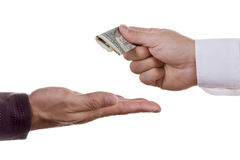 Giving money. Businessman paying money for services or goods royalty free stock image