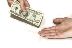 Giving Money in a Hand Royalty Free Stock Photo
