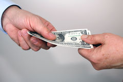 Giving money Royalty Free Stock Photos