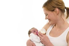 Giving mother with infant, bottle Royalty Free Stock Photos