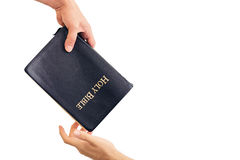 Giving Out A Bible. Male hand giving Bible and evangelizing someone Stock Image