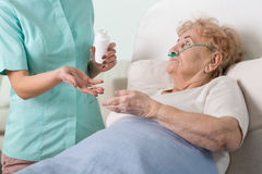 Giving the pills Royalty Free Stock Photo