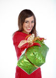 Giving A Present. Conceptual Portrait Photo Of A Woman Giving A Present Royalty Free Stock Photo