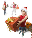 Giving a present. Little girl giving a present to someone, while other childs waits behind her Royalty Free Stock Image
