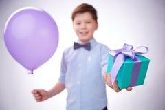 Giving present and balloon stock photos