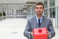 Giving a present to someone special.  Royalty Free Stock Images