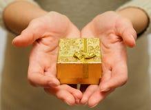 Giving present Stock Photo