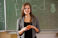 Giving a presentation. Teenager in the classroom giving a presentation on healthy food Stock Images