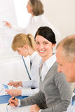 Giving presentation young woman during meeting Royalty Free Stock Image