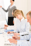 Giving presentation young woman during meeting Stock Photos