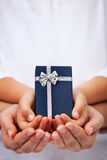 Giving presents concept for the holidays Stock Photos