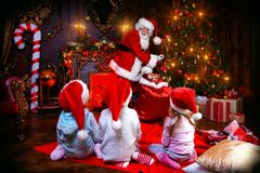Giving presents to children stock images