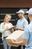 Giving quittance to delivery man Stock Photos