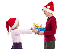 Giving and receiving Christmas present Royalty Free Stock Photography