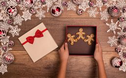 Giving or receiving gingerbread people cookies as christmas pres Stock Images
