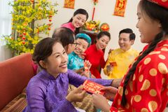 Giving a red envelope for Tet Royalty Free Stock Images