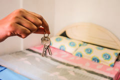 Giving room keys. Renting or lodging rooms handing over keys Stock Photo