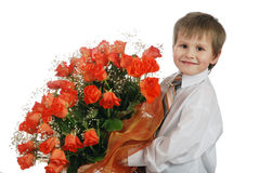 Giving roses boy. Little boy gives red roses Stock Photo