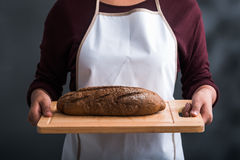 Giving rye bread Stock Image