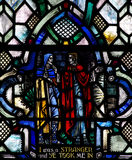 Giving shelter to people (good deed in stained glass) Royalty Free Stock Photography