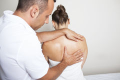 Giving a spine massage Royalty Free Stock Images