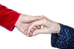 Giving Support, Helping, Holding Hand. Young female holding adult female`s hand concept Royalty Free Stock Photo