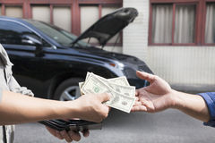 Giving and taking money for car. Service concept Royalty Free Stock Photography