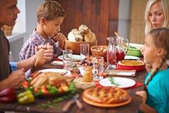 Giving thanks for dinner Stock Photo