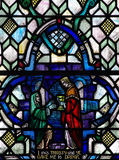 Giving thirsty people a drink (good deed in stained glass) Stock Photos
