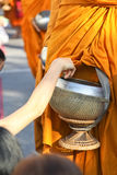 Giving to aims of thai monks. royalty free stock photos