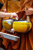 Giving to aims of thai monks. Stock Image