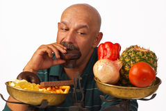 Giving in to temptation. Failing to keep up the diet royalty free stock images