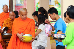 Giving to thai monks Stock Photography