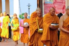 Giving to thai monks Royalty Free Stock Photo