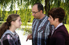 Giving a tongue-lashing. Parents are angry with their teenager girl Royalty Free Stock Images