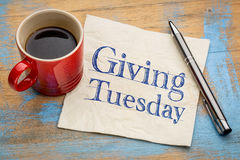 Giving Tuesday concept on napkin with coffee Royalty Free Stock Photo