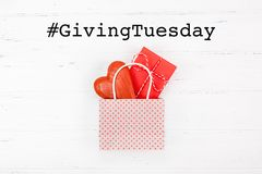 Free Giving Tuesday Concept With Heart And Gift In Bag Royalty Free Stock Photos - 164576468