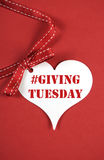 #Giving Tuesday white heart on red - vertical. Stock Photo